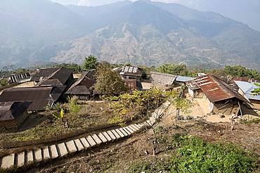 Recently constructed concrete steps to ease access between higher and lower sections of village on steep Naga hillside, Nagaland, India, Asia