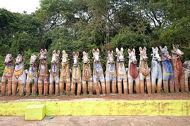 Terracotta horses, each a votive offering to village guardian deity, Ayyanar, at the Solai Andavar shrine, Palathur, Tamil Nadu, India, Asia