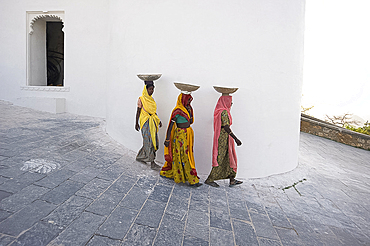 Three female construction workers at the Monsoon Palace, Udaipur, Rajasthan, India