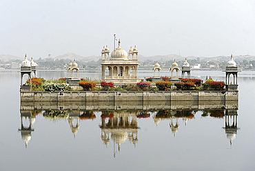 Vijay Raj Rajeshwar temple, reflected in the waters of the Gaibsagar Lake, built in 1923, dedicated to Lord Shiva, Dungarpur, Rajasthan, India, Asia