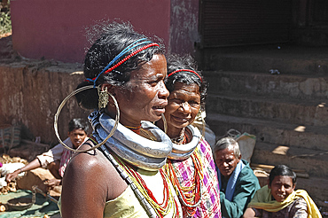 Gadaba tribeswomen in traditional dress with large earrings and necklaces denoting their tribe, Onukudelli, Orissa, India, Asia