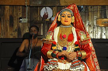 Contemporary female performer in a Kathakali dance depicting folk mythologies from the Hindu epics, Nilambur, Kerala, India, Asia