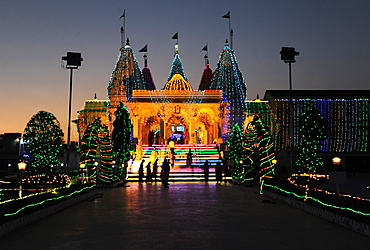 Diwali festival lights illuminating the entrance to the white marble Swaminarayan Temple, Mandvi, Gujarat, India, Asia