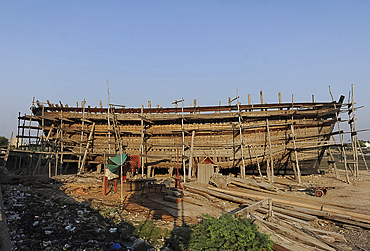 Ocean going dhow, constructed by hand from Sal wood in 400 year old tradition, on the Rukmavati River, Mandvi, Gujarat, India, Asia