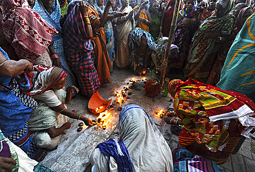 Widows gathered to celebrate Kartika Brata month long festival by fasting together and burning puja lamps, Puri, Odisha, India, Asia