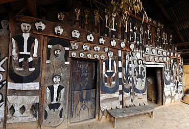 Traditional Naga village house front, decorated with tribal head-hunting icons, Mao Maram, Manipur, India, Asia