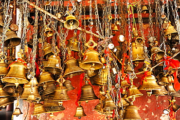 Ritual bells for worshippers at the entrance to the Hindu Sivadol temple, Sivasagar, Assam, India, Asia