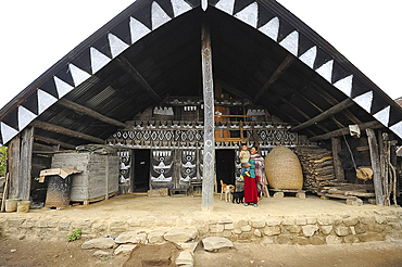 Mother and her child outside their traditionally decorated Naga home, Nagaland, India, Asia