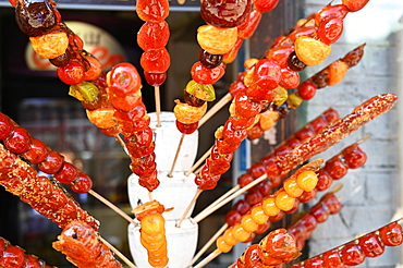 Tanghulu, skewered sugar-glazed berries sold in the outdoor market places or from street carts, Beijing, China, Asia