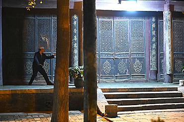 Man doing Tai Chi in inner courtyard of Xian Great Mosque before evening prayer, Xian, Shaanxi, China, Asia