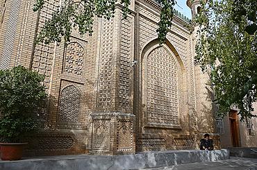 Man outside ornate mosque in city centre, Hotan, Xinjiang, China, Asia