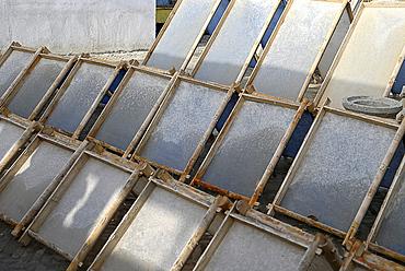 Hand made paper made from mulberry tree bark drying in the sun, Moyen, Hotan, Xinjiang, China, Asia