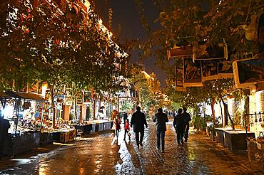 People walking in the main street at night, Old Kashgar, Xinjiang, China, Asia