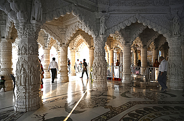 Visitors to the white marble Swaminarayan temple, built following the 2001 earthquake, Bhuj, Gujarat, India, Asia