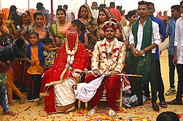 Bride and groom with guests at their wedding as part of tented multiple wedding ceremony, Bhuj, Gujarat, India, Asia