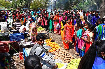 Adivasi villagers at traditional rural village fair celebrating Holi festival, Gujarat, India, Asia