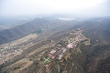 Amber Fort in Aravali hills, seen from the air, looking towards Jaipur in the distance, Rajasthan, India, Asia