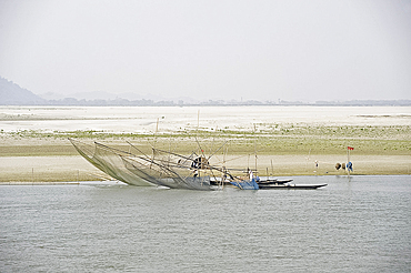 Fishermen working nets on the banks of the Brahmaputra River, near Guwahati, Assam, India, Asia