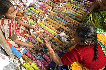 Woman buying bangles (churidar) from stall at Sonepur Cattle Fair, near Patna, Bihar, India, Asia