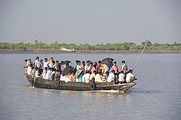 Small wooden ferry boat crowded with people, Gothakali Port, Sunderbans, West Bengal, India, Asia