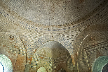 Domed interior and arches of the 15th century Lattan mosque, showing alternating horizontal bands of bricks, Gaur, West Bengal, India, Asia