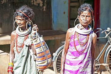 Two Gadaba tribeswomen each with traditional jewellery denoting their tribe, at Bonda tribal street market, Rayagader, Orissa, India, Asia