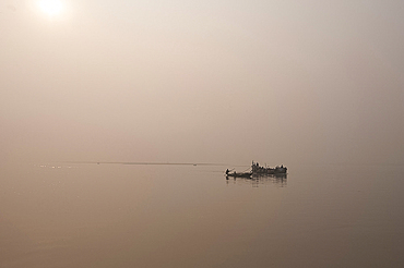 Fishing boats and ferry on the River Ganges in the early morning, Sonepur, Bihar, India, Asia