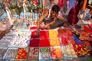 Man selling abir, a red powder used for marking teeka on the forehead, and other Hindu trinkets, Sonepur, Bihar, India, Asia