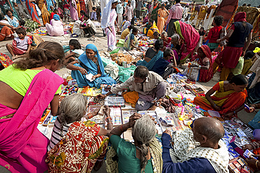 Village women surrounding a stall selling hair products at the Sonepur Cattle fair, Bihar, India, Asia