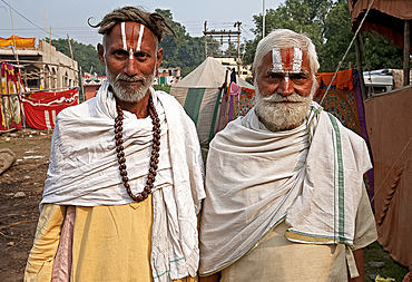Two men with Vaishnavite sandalwood tilaks on their foreheads, one man with long uncut hair, Sonepur Cattle Fair, Bihar, India, Asia