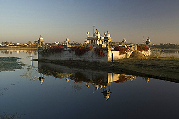 Reflection of temple in lake at dawn, Dungarpur, Rajasthan, India, Asia