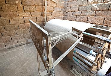 Silk thread being spun on large wooden handmade wheel, rural Orissa, India, Asia