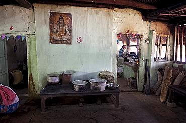 Man cooking in roadside dhaba (restaurant), rural Orissa, India, Asia