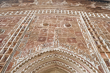 Carved terracotta work above arched doorway in the Lalji Mandir, one of the terracotta temples at Kalna, West Bengal, India, Asia