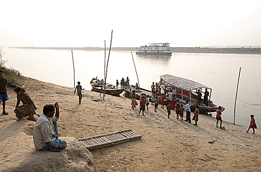 Activity around ferry arrival on the banks of the River Hugli (River Hooghly), rural West Bengal, India, Asia
