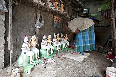 Deity maker with his deities, Kumartuli district, Kolkata, West Bengal, India, Asia