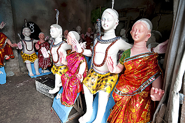 Finished, painted and dressed deities ready for offering at festival pujas, Kumartuli district, Kolkata, West Bengal, India, Asia