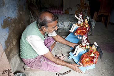 Sculpture with small painted and dressed deities ready for offering at festival pujas, Kumartuli district, Kolkata, West Bengal, India, Asia