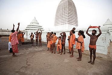 Joranda monks chanting in ritual prayer at dusk at temple containing dhuni, eternal butter lamp, Joranda, Dhenkanal, Orissa, India, Asia