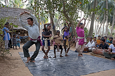 A demonstration of traditional Gotipua (single boy) temple dancing taking place in musician's village, Ballia, Orissa, India, Asia