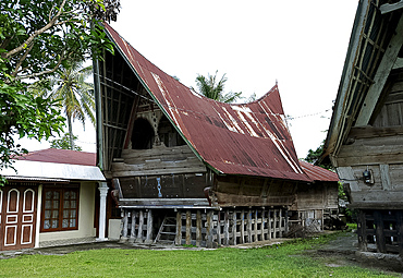 Batak Toba tribal rural village houses with contemporary extensions on Samosir Island in Lake Toba, Sumatra, Indonesia, Southeast Asia, Asia
