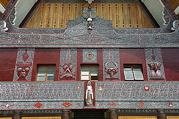 Ornate traditional Batak painted carvings on large Batak style Catholic church, Pangururan, Samosir Island, Sumatra, Indonesia, Southeast Asia, Asia