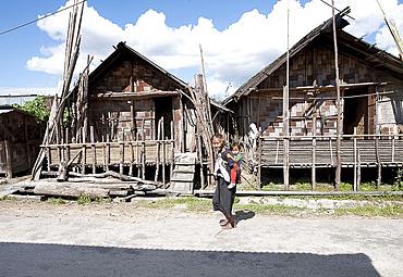 Apatani grandmother and child in Apatani tribal village street of traditional bamboo built houses, Ziro, Arunachal Pradesh, India, Asia