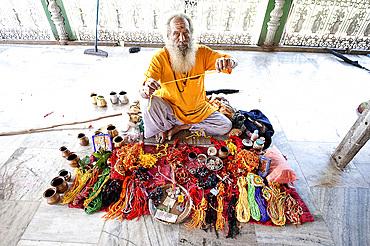 Hindu pundit selling rolimoli (puja wrist threads) in the Sivadol temple, built in 1734, Sivasagar, Assam, India, Asia