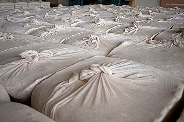 Large bales of processed cotton bound in cotton cloth ready for transport from factory, Rajkot district, Gujarat, India, Asia