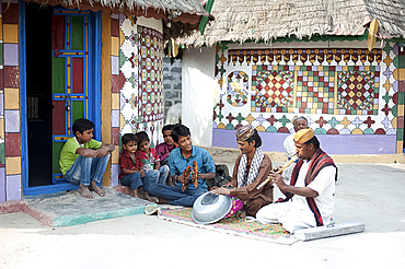 Village musicians, instruments made from metal bowl and terracotta water pot, pipe and cymbals, Bhirindiara, Kachchh, Gujarat, India, Asia