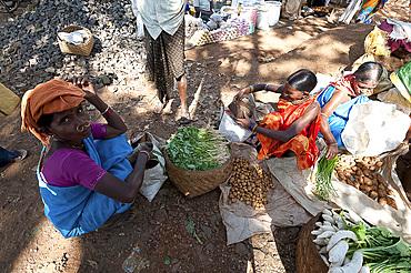 Mali tribal woman with gold nose rings shopping by bartering system in Mali weekly tribal market, Guneipada, Orissa (Odisha), India, Asia