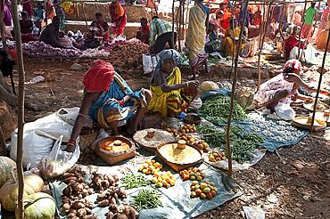 Vegetable stalls in Mali weekly tribal market, Guneipada, Koraput district, Orissa (Odisha), India, Asia