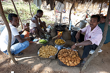 Bhaji and savoury snack stall in Mali weekly tribal market, Guneipada, Koraput district, Orissa (Odisha), India, Asia