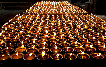 Butter lamps lit in Mongar Dzong (monastery), built in the 1930s, one of Bhutan's newest dzongs, built without plans or nails, Bhutan, Asia